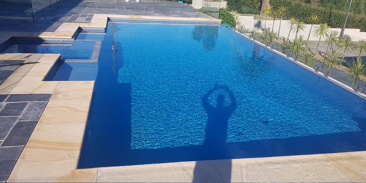 salt attacks sandstone pool coping